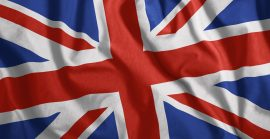 The British Flag Is Flying In The Wind Colorful, National Flag Of Great Britain Patriotism